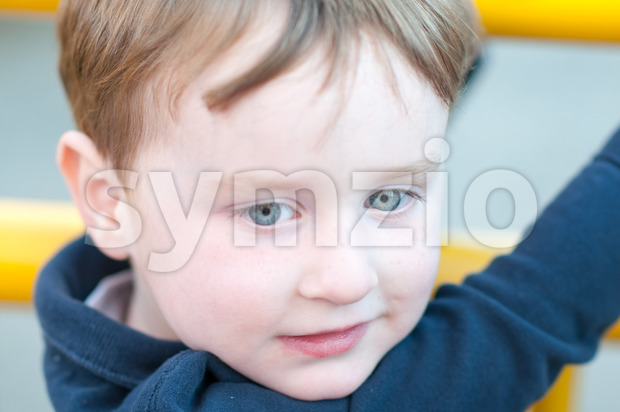 View of Close up Portrait of young boy outside