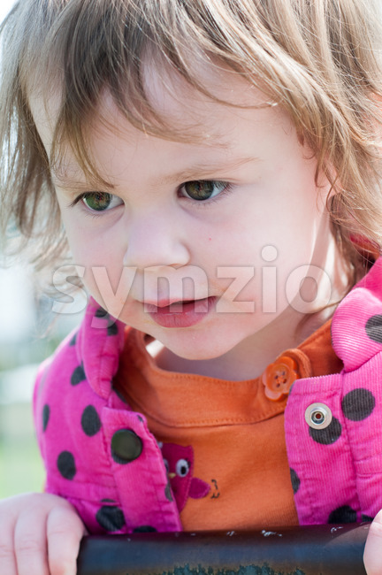 Happy little girl is swinging on see-saw Stock Photo