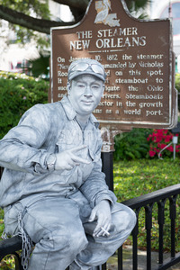 NEW ORLEANS, LA - APRIL 13: Street actor dressed up as a tin man in front of the Steamer historical sign on April 13, 2014 Stock Photo