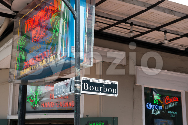 NEW ORLEANS, LA - APRIL 13: Bourbon and Orleans Street sign in the French Quarter of New Orleans, Louisiana on April 13, 2014 Stock Photo