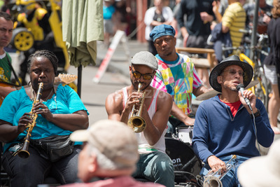 NEW ORLEANS - APRIL 13: In New Orleans, a jazz band plays jazz melodies in the street for donations from the tourists and locals passing by on April Stock Photo