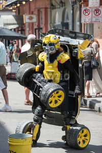 NEW ORLEANS, LA - APRIL 13: Street performer in New Orleans, man transforms between car and robot on April 13, 2014 Stock Photo