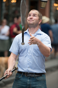 NEW ORLEANS, LA - APRIL 13: Juggler performs on street in New Orleans, LA on April 13, 2014 Stock Photo