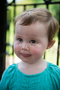 Portrait of young girl riding on train Stock Photo