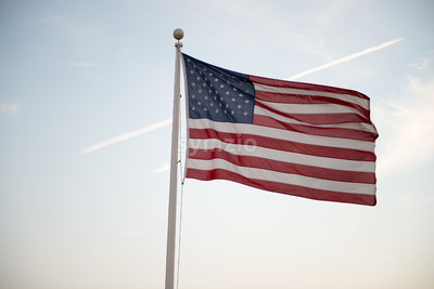 Flag of the United States of America waving at sunset Stock Photo