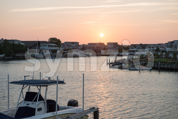 AVALON, NJ - AUGUST 30: View of Avalon Bay, beautiful bay with view of mansions and yachts at sunset on ...