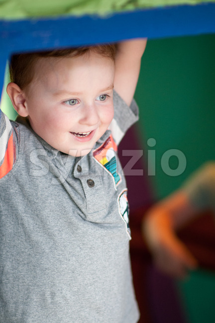 Young toddler boy having fun on boardwalk amusement ride Stock Photo