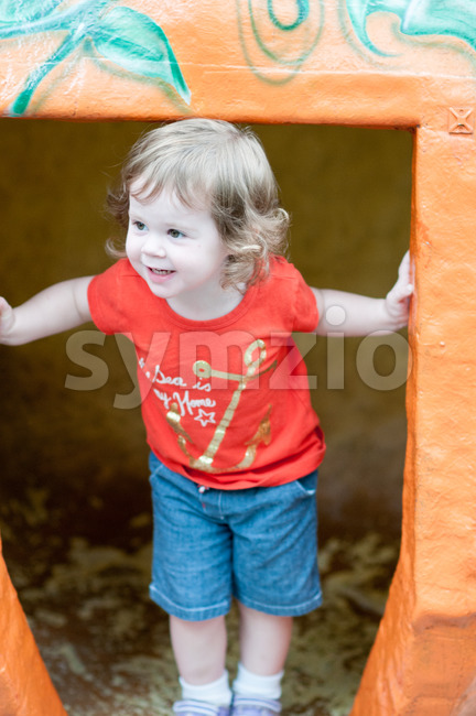 Young toddler girl having fun on boardwalk amusement ride Stock Photo