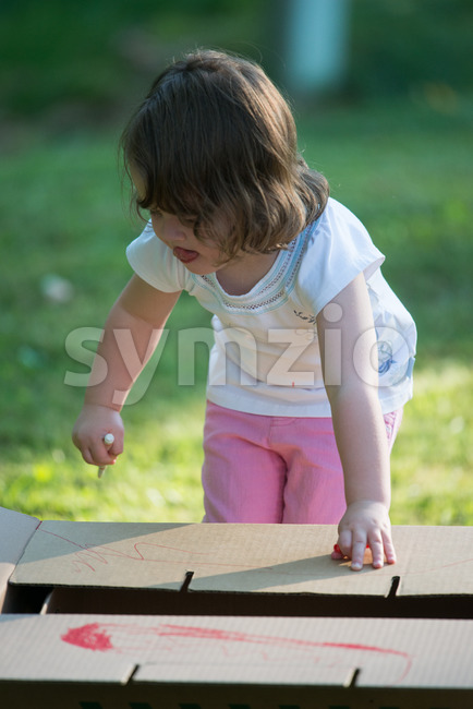 Young girl outside coloring with markers Stock Photo