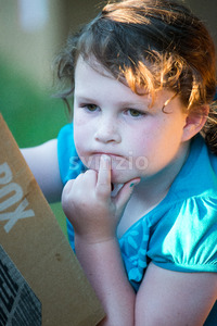 Portrait of beautiful attractive young girl thinking outside at sunset Stock Photo