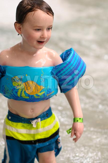 Little boy swimming in indoor pool Stock Photo