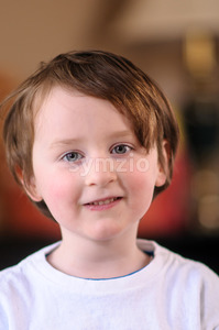 Portrait of a cute little boy smiling Indoors Stock Photo