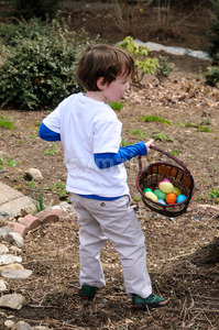 Young Boy Outside Dressed Up for Easter holding Basket Stock Photo