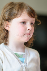 Portrait of a cute little girl inside Stock Photo