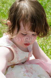 Portrait of a cute little girl smiling outside Stock Photo