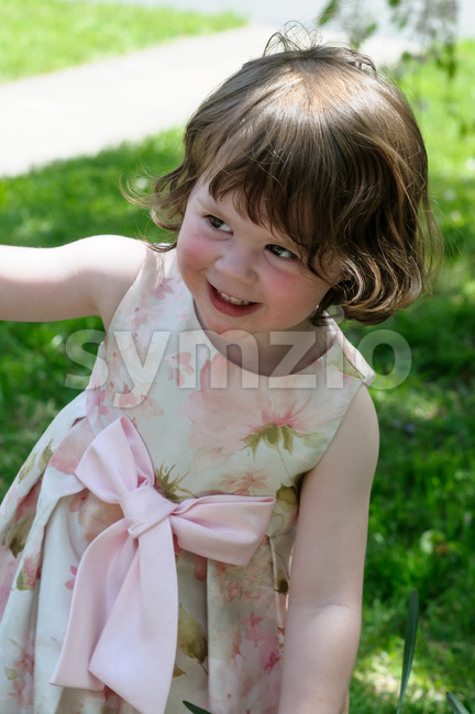 View of Portrait of a cute little girl smiling outside