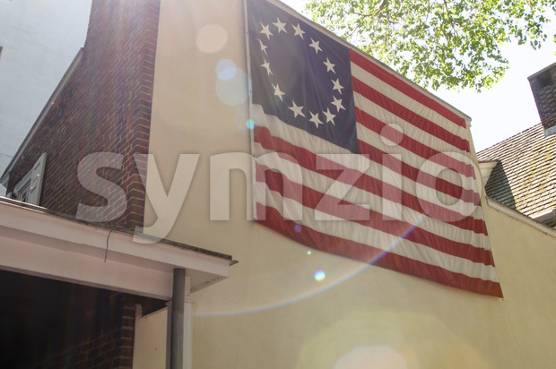 PHILADELPHIA, PA - MAY 14: American thirteen point historic flag often named the Betsy Ross flag, in front of the Betsy Ross House at 239 Arch Street Stock Photo