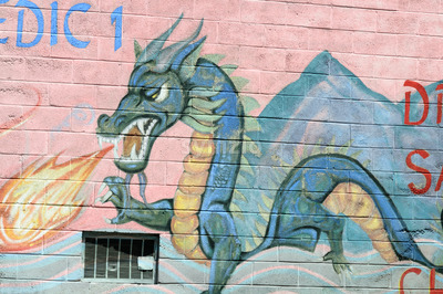 PHILADELPHIA, PA - MAY 14: Fire breathing dragon graffti artwork mural in the Chinatown section of downtown Philadelphia on May 14, 2015 Stock Photo