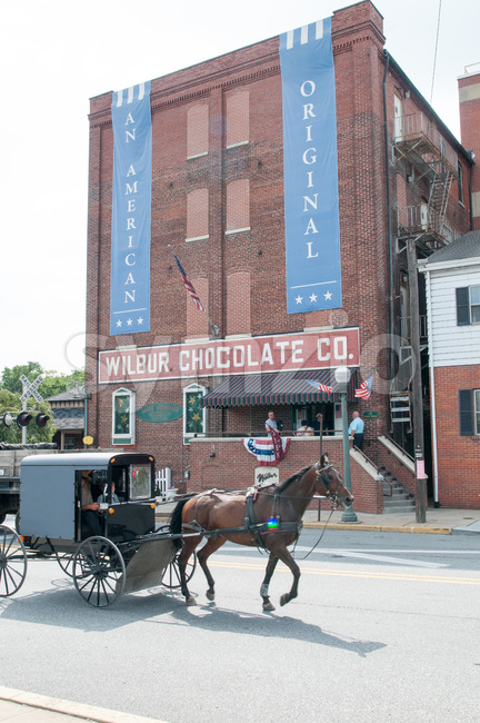 LITITZ, PA - AUGUST 30: Amish horse and buggy riding past the famed Wilbur Chocolate Company headquarters on Route 501 in Lititz on August 30, 2014 Stock Photo