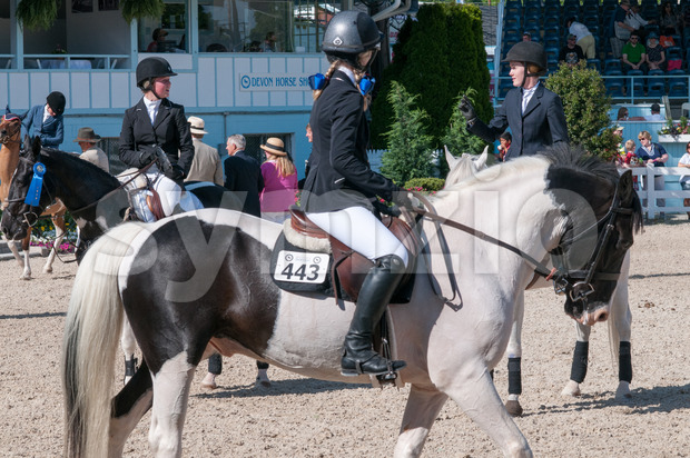 DEVON, PA - MAY 25: Riders performing with their horses at the Devon Horse Show on May 25, 2014 Stock Photo