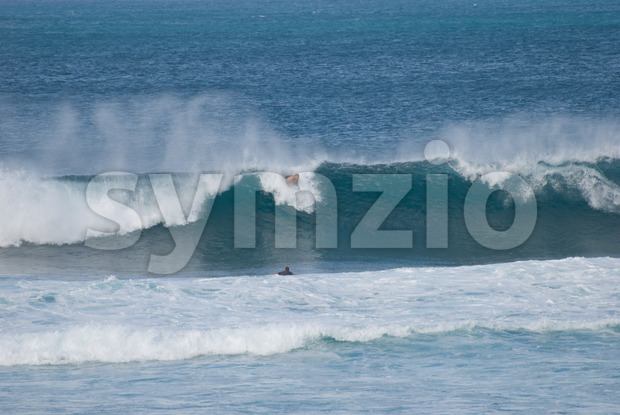 MAUI, HI - DECEMBER 8: Surfers ride a big waves in Maui on December 8, 2007 Stock Photo
