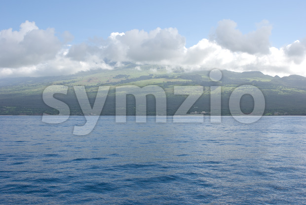 Maui with Molokini Crater. Molokini is popular for scuba diving and snorkeling Stock Photo