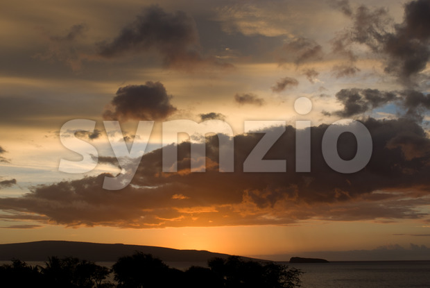 Tropical Sunset over beach in Maui Hawaii Stock Photo