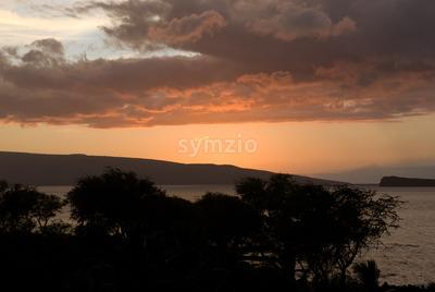 Tropical Sunset over beach in Maui Hawaii Stock Photo