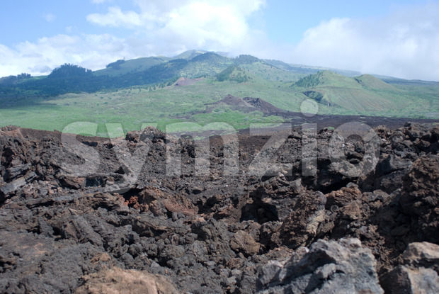 Black lava rocks line the shore at Keanae on the road to Hana in Maui, Hawaii Stock Photo