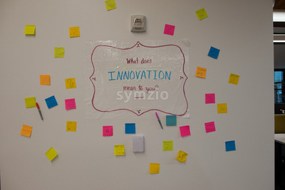 Sign on office wall, what does innovation mean to you Stock Photo