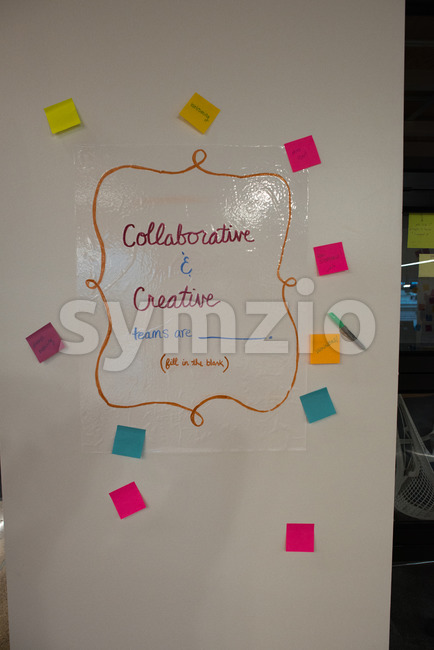 Sign on office wall, collaborative and creative teams are Stock Photo