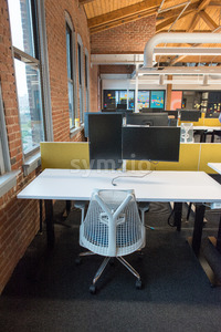 Trendy modern open concept loft office space with big windows, natural light and a layout to encourage collaboration, creativity and innovation Stock Photo