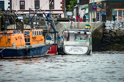 DINGLE, IRELAND - AUGUST 21, 2017: Irish seaport scenery in Dingle, County Kerry, Ireland Stock Photo