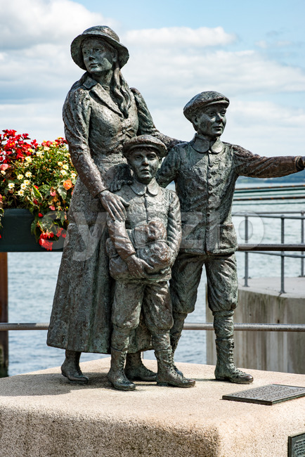 The Annie Moore Memorial, statue of Annie Moore and her two Brothers in Cobh, Ireland Stock Photo