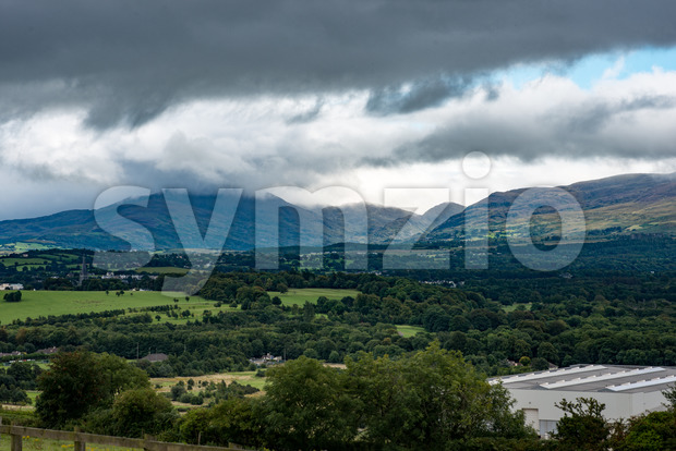 View of Mountains, Fields and Lake on Cloudy Day in Killarney Ireland