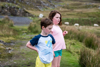 Boy and girl walking up the Slieve League Cliffs, County Donegal, Ireland Stock Photo