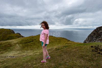 Girl looking out over the Slieve League Cliffs, County Donegal, Ireland Stock Photo
