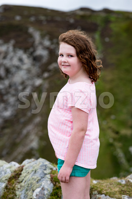 Girl looking out over Slieve League Cliffs, County Donegal, Ireland Stock Photo