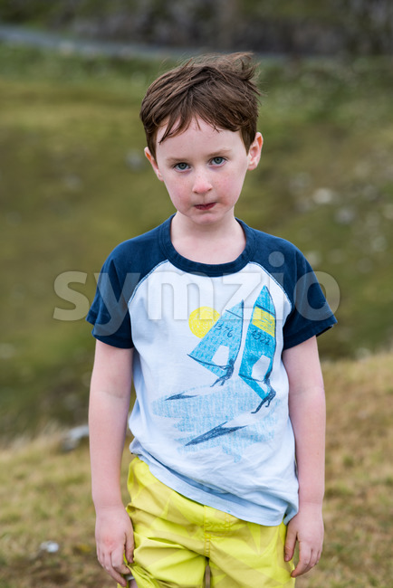 Boy walking up the Slieve League Cliffs, County Donegal, Ireland Stock Photo
