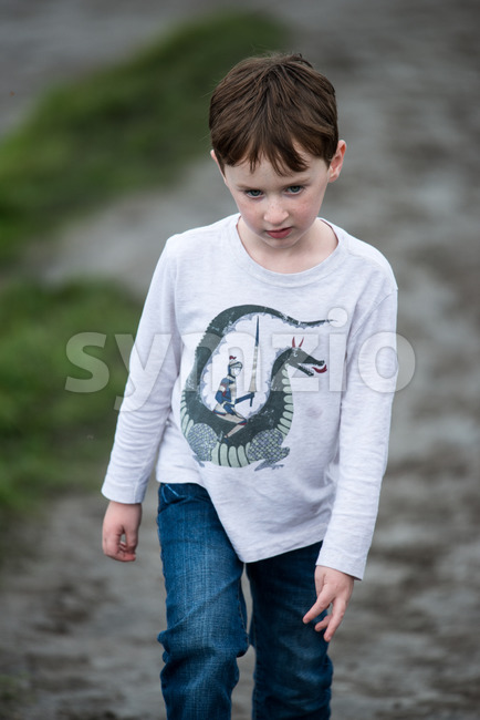 Boy walking up the Cliffs of Moher Tourist Attraction in Ireland Stock Photo