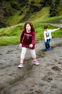 Boy and Girl walking up the Cliffs of Moher Tourist Attraction in Ireland Stock Photo