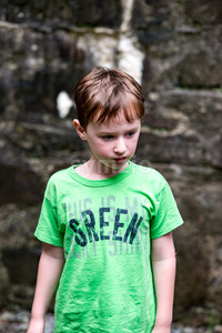Young little boy portrait looking around inside an old castle Stock Photo
