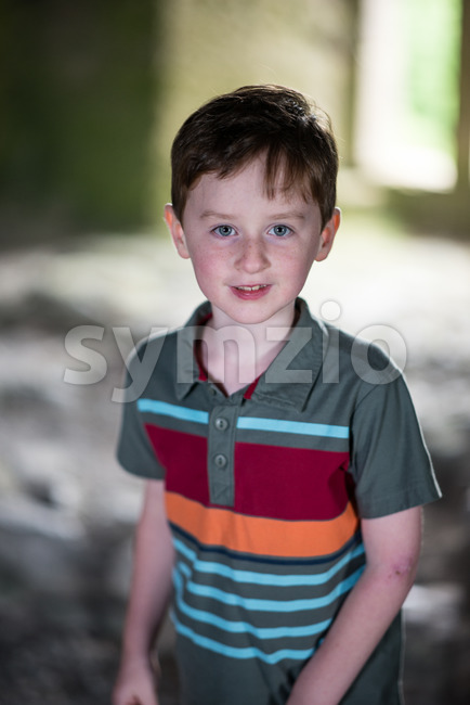 Young little boy portrait looking around inside castle Stock Photo