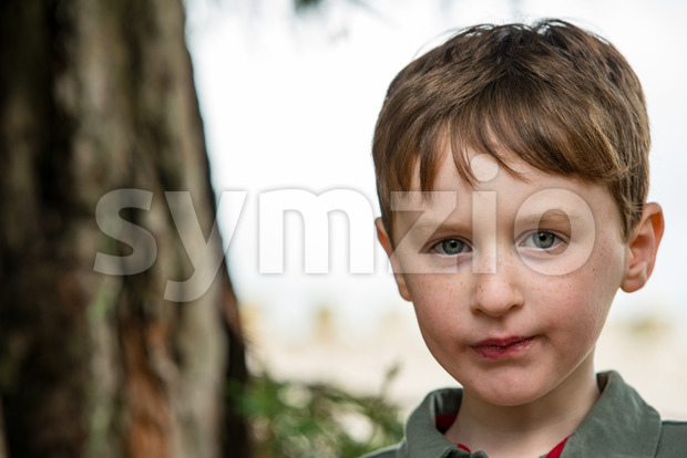 View of Young little boy portrait looking at camera