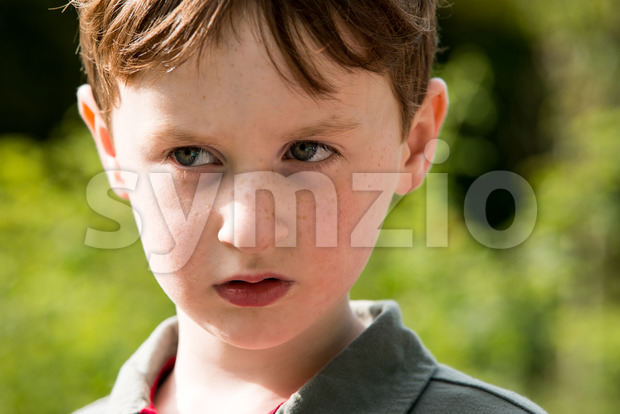 View of Young little boy portrait looking at something