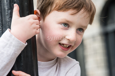 Young little boy portrait looking at something Stock Photo