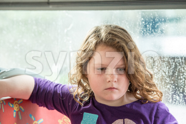 View of Young little girl portrait looking at something