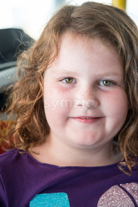 Young little girl portrait looking and smiling at the camera. Stock Photo