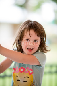 Young girl having fun outside at park on a playground Stock Photo