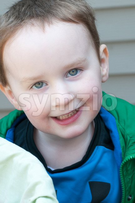 Young little toddler boy with basket of easter eggs Stock Photo